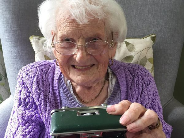 A care home resident holding a memory box
