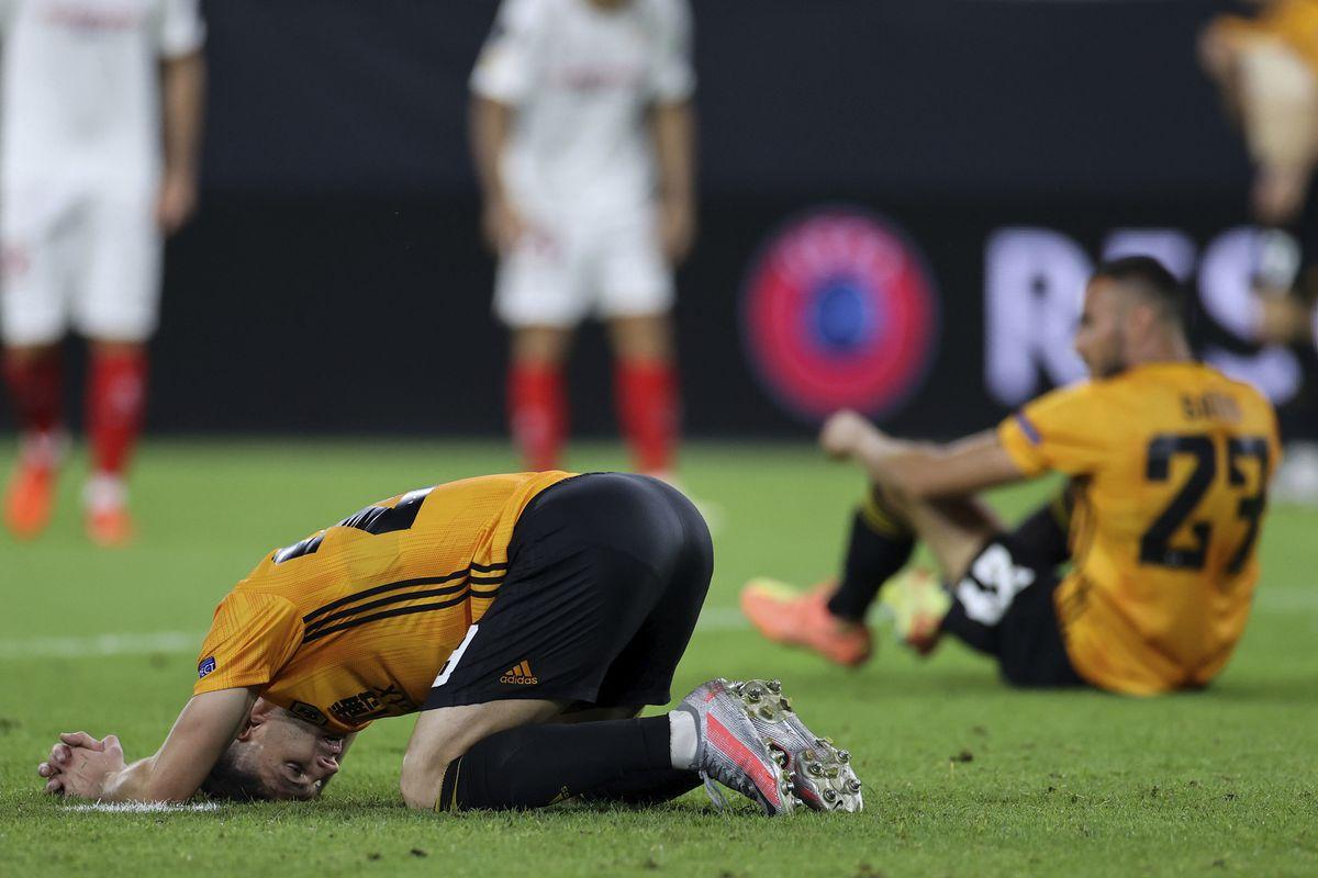 Wolverhampton Wanderers players react after losing 1-0 to Sevilla (PA)