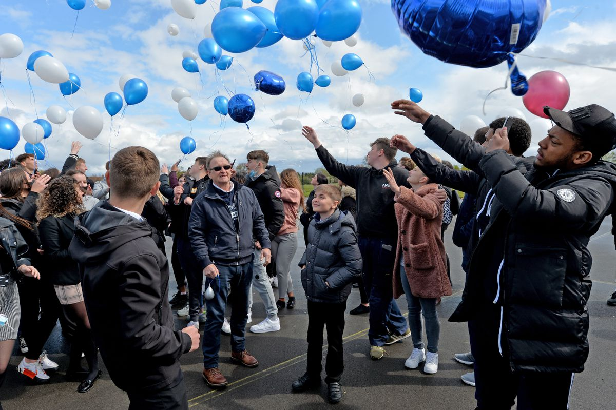 Balloons are released in Farley's memory