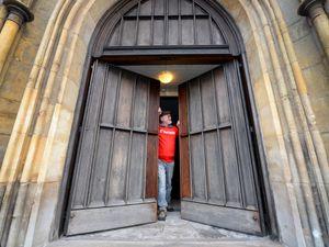 Dr John Edlin admires the newly-restored doors at St Matthews Church, Walsall