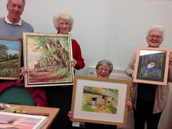 Budding artists lay on library exhibit