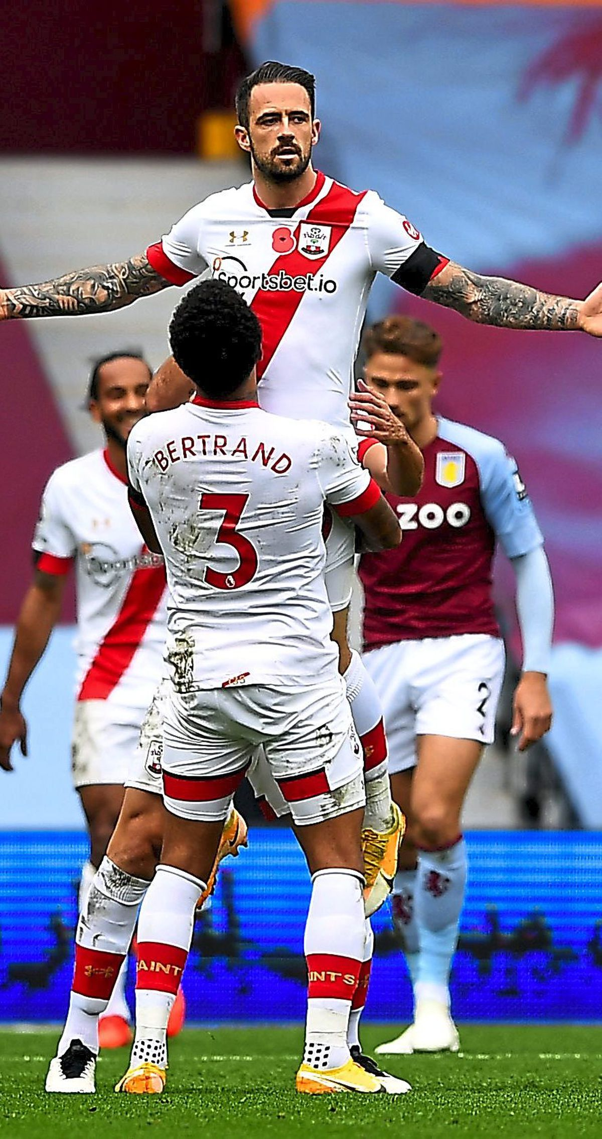 """Southampton's Danny Ings celebrates scoring his side's fourth goal of the game with Ryan Bertrand during the Premier League match at Villa Park, Birmingham PA Photo. Picture date: Sunday November 1, 2020. See PA story SOCCER Villa. Photo credit should read: Gareth Copley/PA Wire. RESTRICTIONS: EDITORIAL USE ONLY No use with unauthorised audio, video, data, fixture lists, club/league logos or """"live"""" services. Online in-match use limited to 120 images, no video emulation. No use in betting, games or single club/league/player publications."""