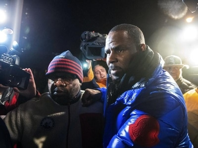 R Kelly arrested and held in custody following sex abuse charges