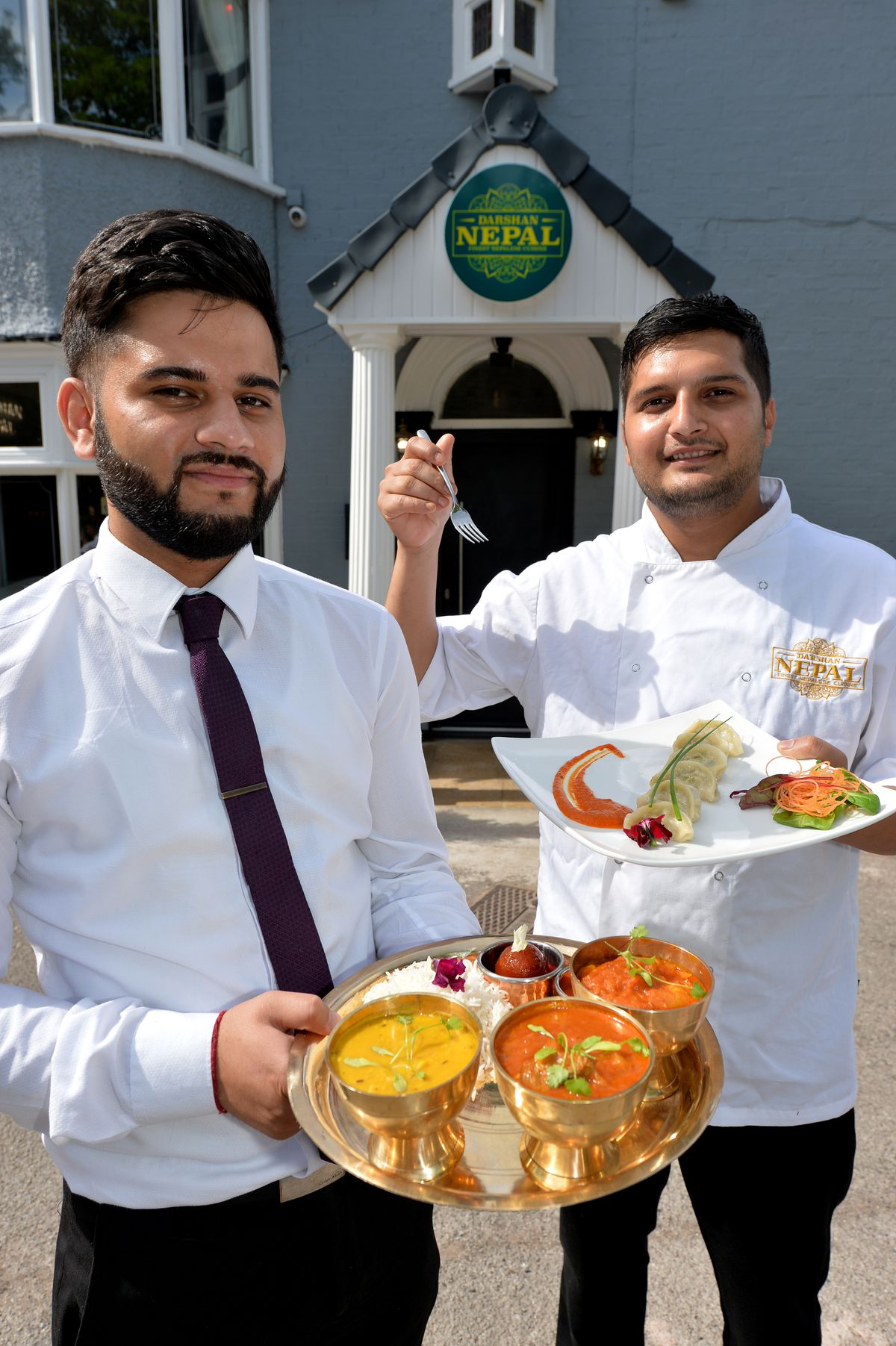 COPYRIGHT TIM STURGESS EXPRESS AND STAR...... 14/06/2021 Sanjog Gaire has opened business doing traditional Nepalese food, the Darshan Nepal, Cannock. 07492 310650 Pictured, left,manager, Saurav Gotame and head chef Sanjog Gaire...