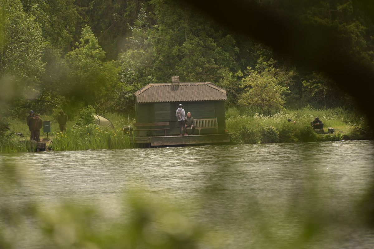 Scott Simpson took this image showing people enjoying chatting by the lake at Himley Park