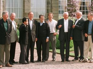"Casual attire for ""the G Men"" at the Weston Park G8 summit. From left: US President Bill Clinton, President of the European Commission Jacques Santer, Japanese Prime Minister Ryutaro Hashimoto, French President Jacques Chirac, Italian Prime Minister Romano Prodi, host and British Prime Minister Tony Blair, Russian President Boris Yeltsin, German Chancellor Helmut Kohl and Canadian Prime Minister Jean Chretien."