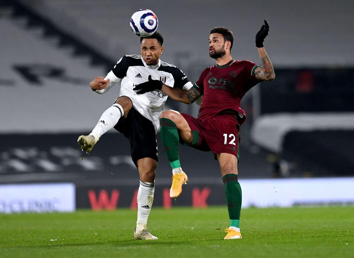 Kenny Tete (left) and Wolverhampton Wanderers' Willian Jose