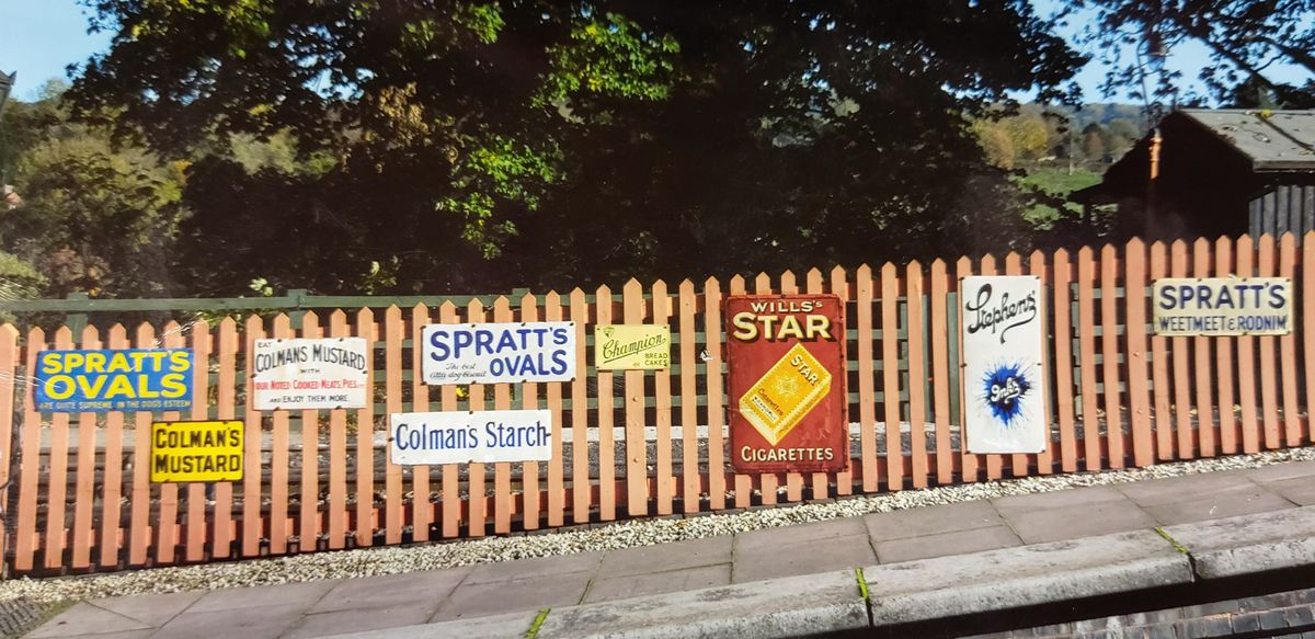 The Spratt's signs on the far left and right have been stolen, along with the Colman's mustard and Champion bread cakes signs