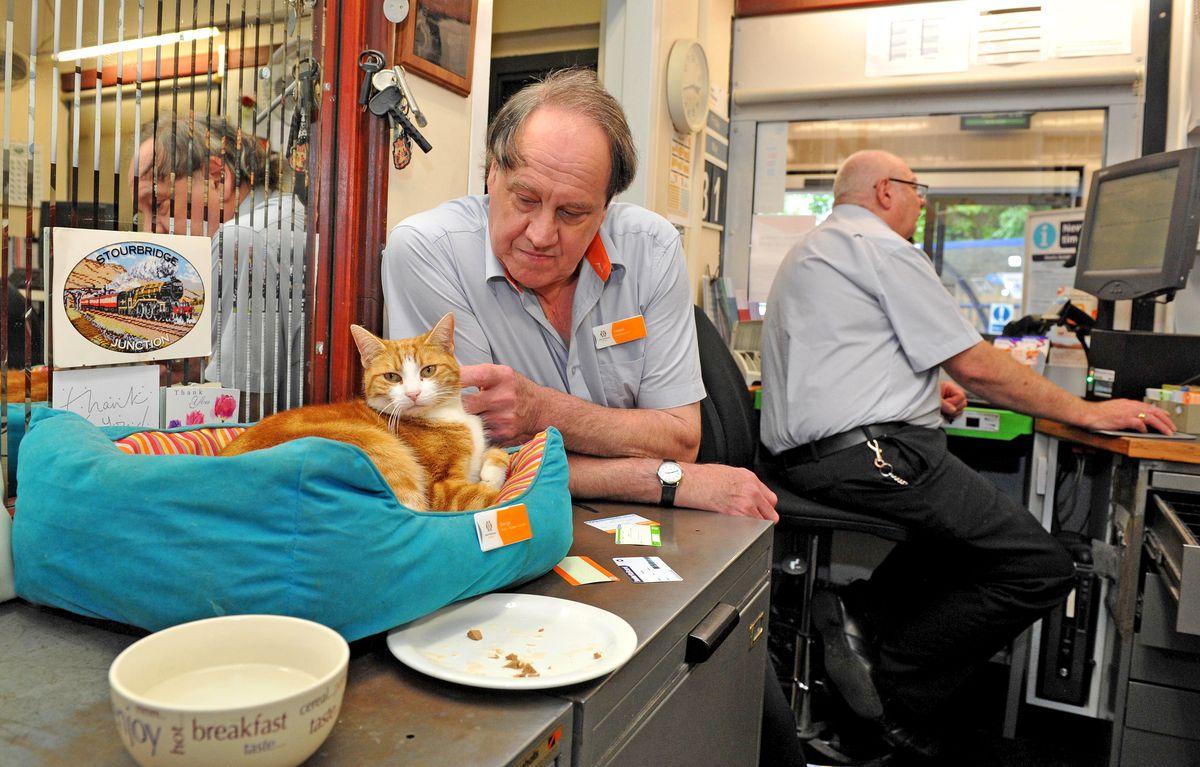George and station supervisor Ian Tomlinson hard at work at Stourbridge Junction station
