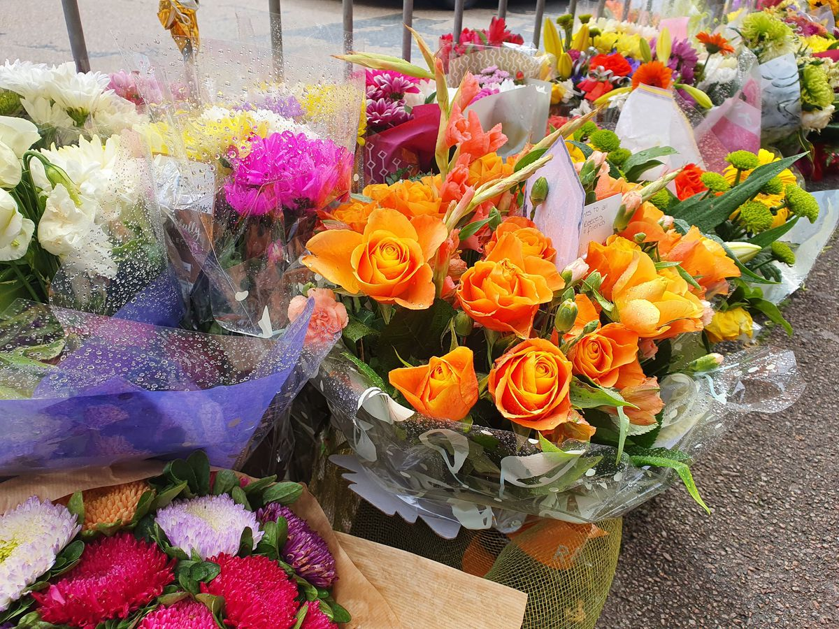 Some of the flowers left as tributes