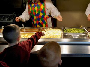 The firm provides 15,000 school meals a day