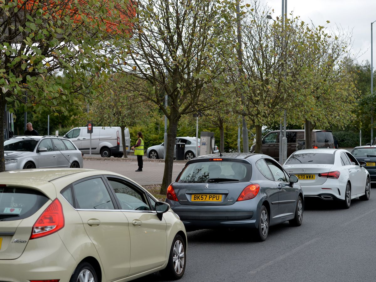 Drivers queue for fuel at Sainsbury's petrol station at Reedswood Retail Park, Walsall, on Saturday