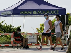 Florida reports record coronavirus cases as US holiday weekend causes concern