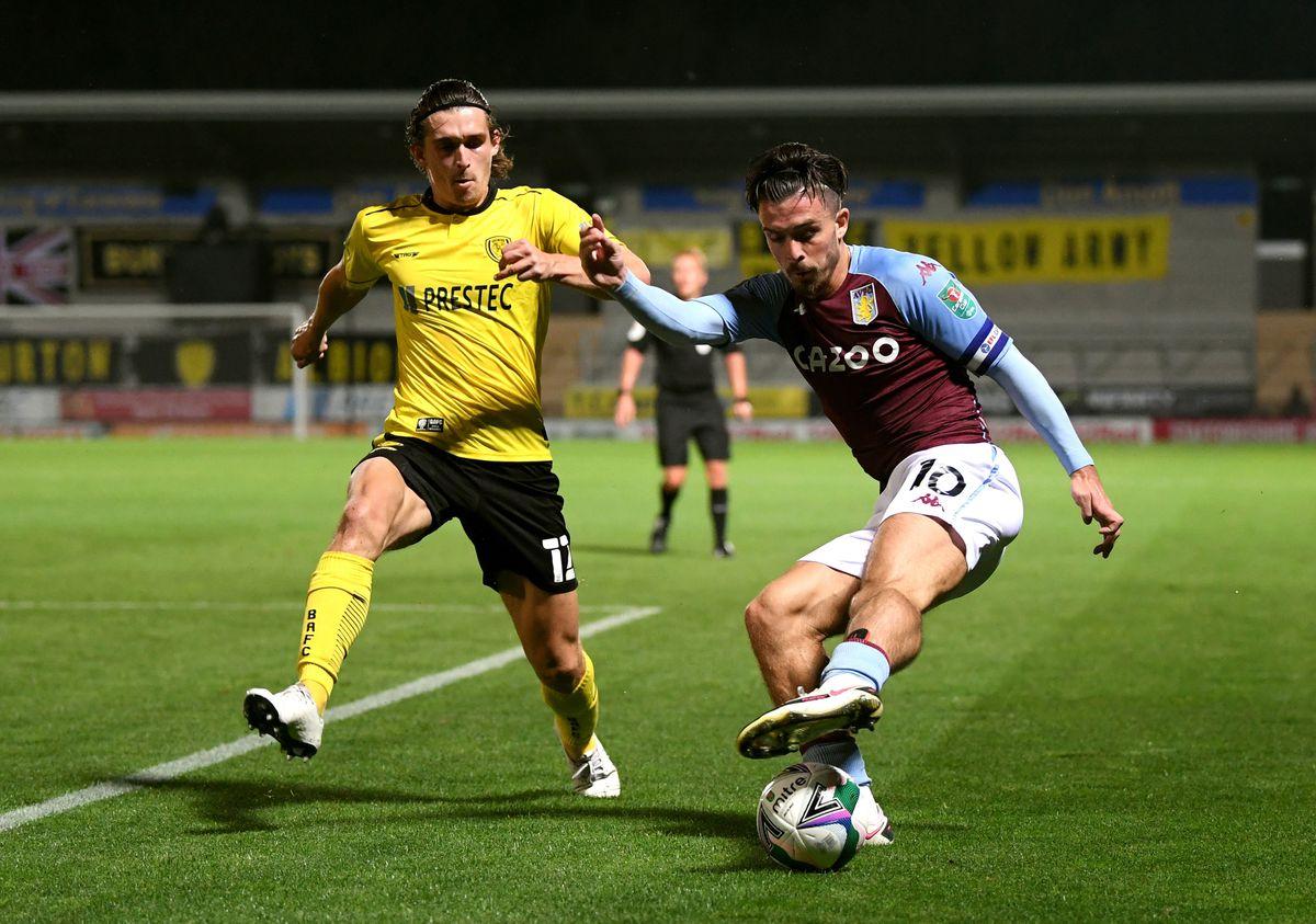Burton Albion's Ben Fox (left)and Aston Villa's Jack Grealish