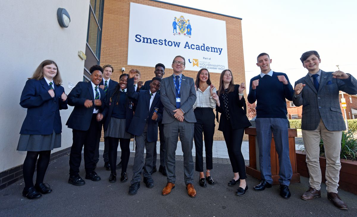 Executive headteacher Clive Jones with some of the pupils at Smestow Academy in Wolverhampton