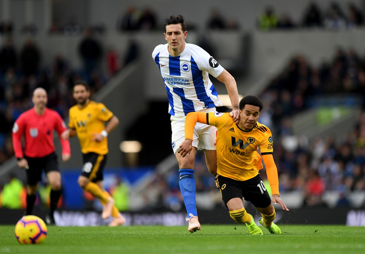 Lewis Dunk of Brighton & Hove Albion and Helder Costa of Wolverhampton Wanderers. (AMA/Sam Bagnall)