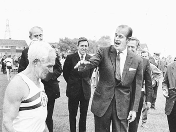 1971: On your marks... Philip starts off veteran Tipton athlete Jack Holden at the official opening of Tipton Sports Union's new stadium