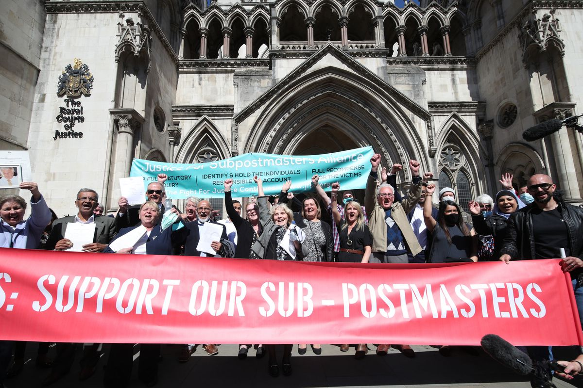 Former post office workers celebrate outside the Royal Courts of Justice after having their convictions overturned by the Court of Appeal