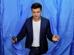 Comedian claims landslide win in Ukraine's presidential election, exit poll says
