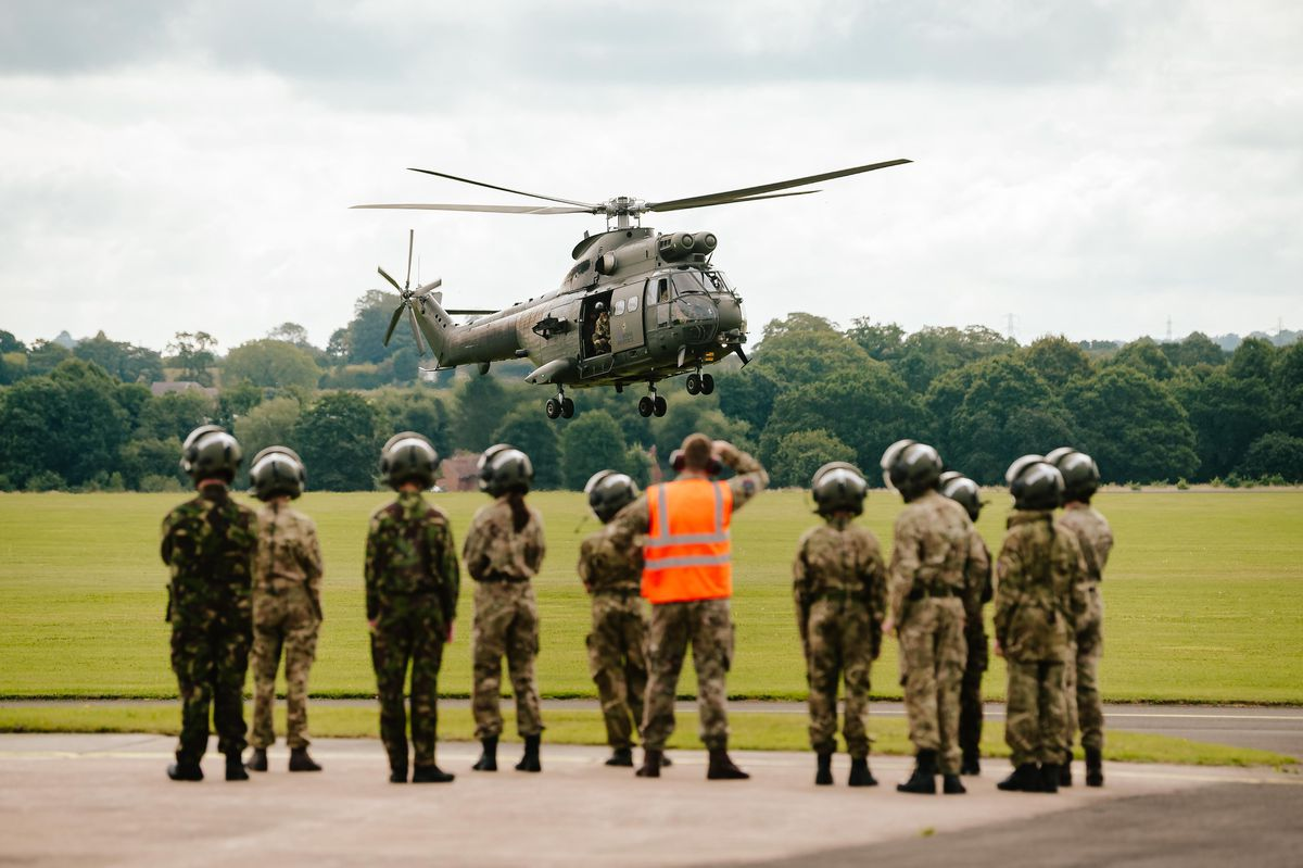Air Cadets watch over an RAF Puma Helicopter