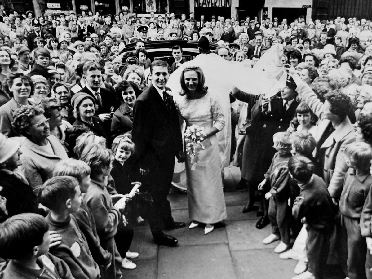 Crowds lined the streets of Huddersfield for Hugh and Anita's wedding in 1965