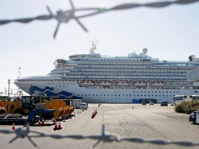 Two passengers die after being taken off virus-hit cruise ship in Japan