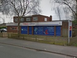 Masked raider shoves security worker during robbery at Tesco Express
