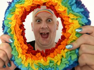 Paul Ryder of LGBT+ Sparkle with one of the rainbow wreaths
