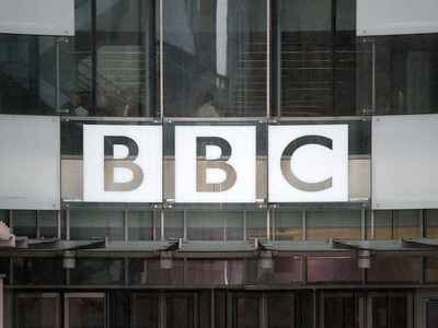 BBC seeks to resolve row with its own presenters over tax bills