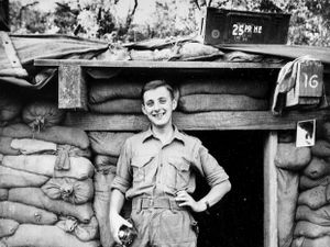 """Young National Serviceman Alan outside his """"residential bunker"""" in Korea."""