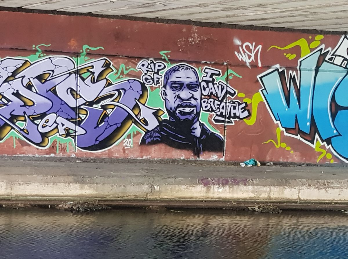An artist has painted a mural to George Floyd under the M6 bridge near Walsall canal
