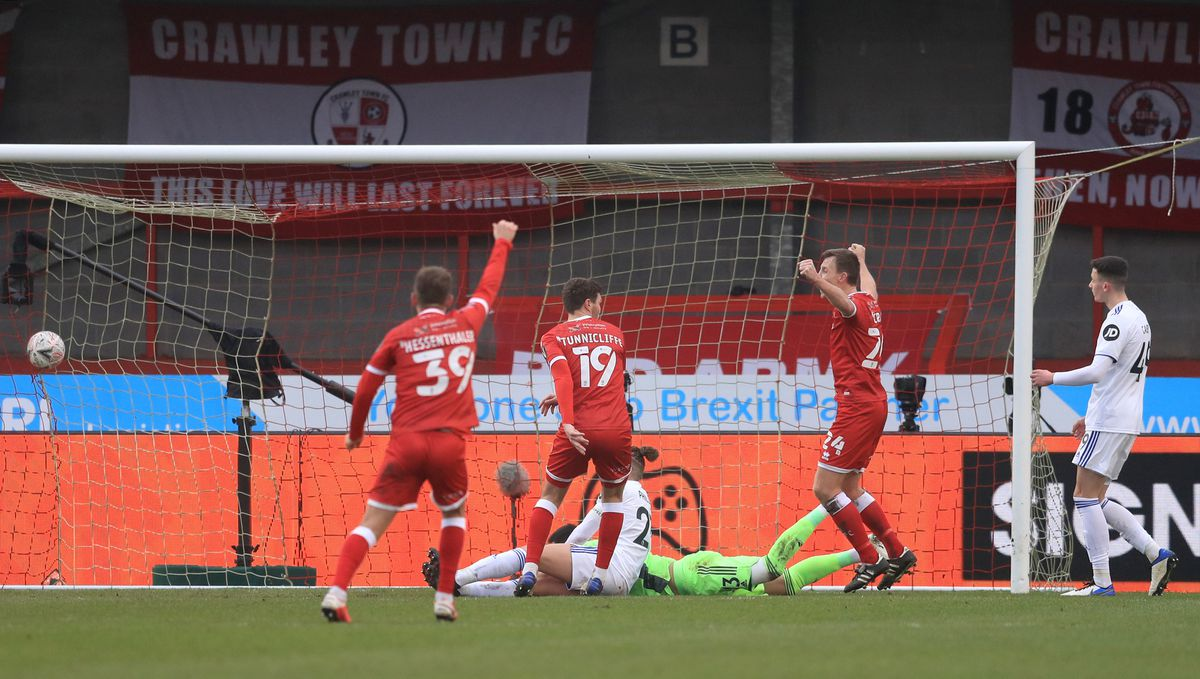 Crawley Town's Jordan Tunnicliffe (centre) scores his side's third goal of the game