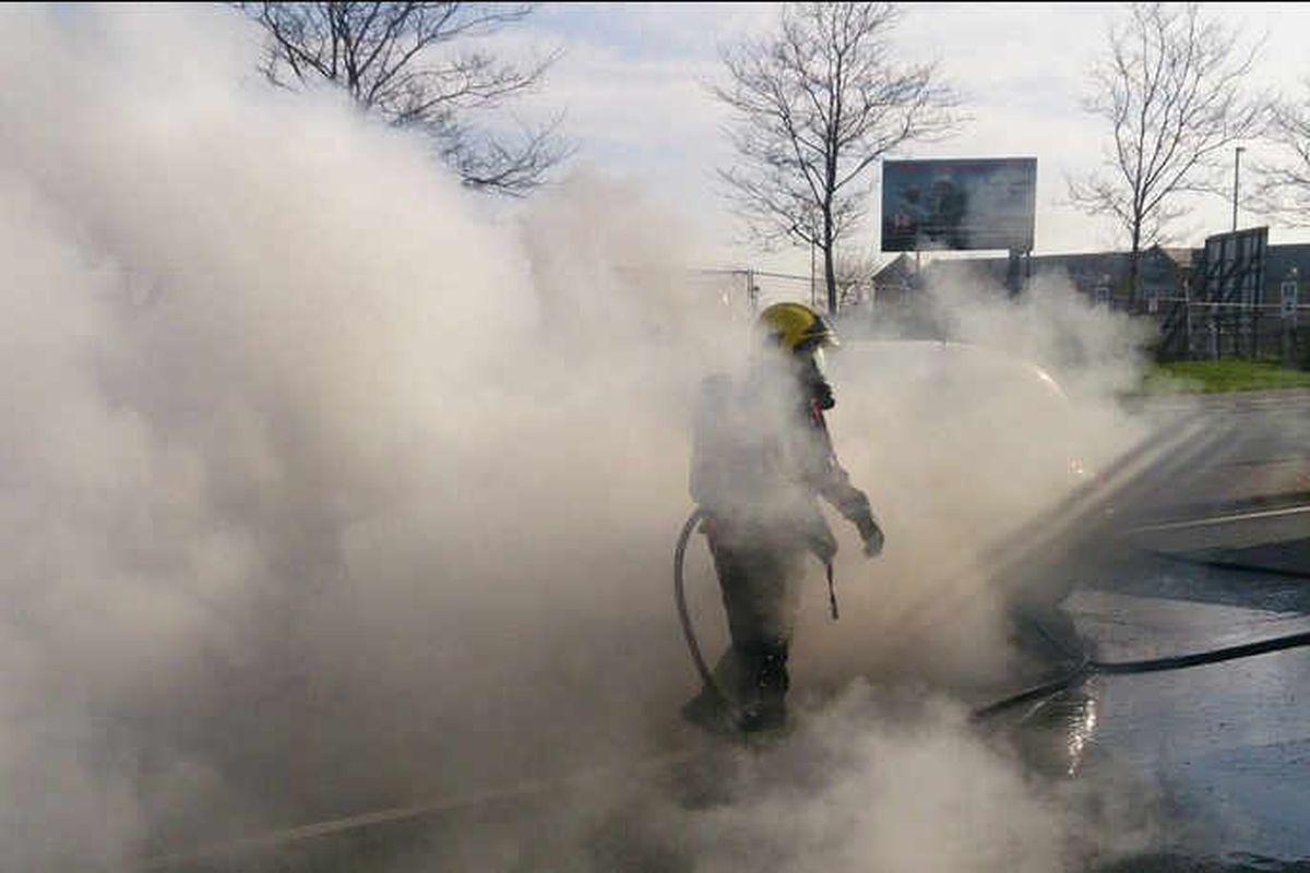 Car destroyed as blaze shuts Birmingham Road