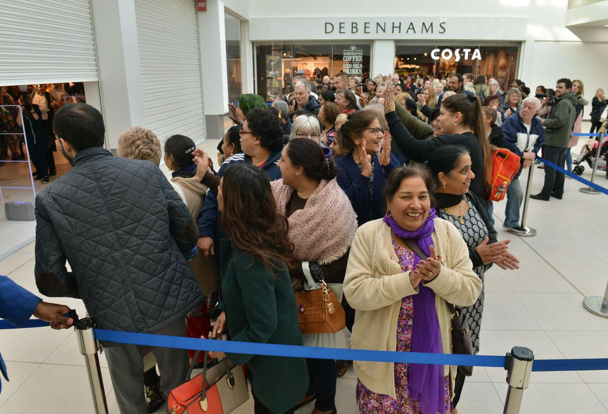 Excited shoppers as the shutters are lifted