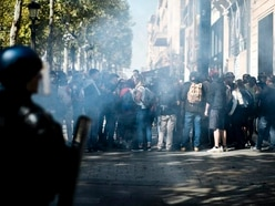 Police use tear gas in Paris amid array of protests