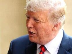 Trump calls EU global foe as he arrives in Finland for Putin summit