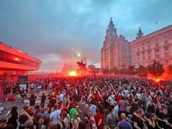 Liverpool FC condemns fans' behaviour as Liver Building burns amid celebrations