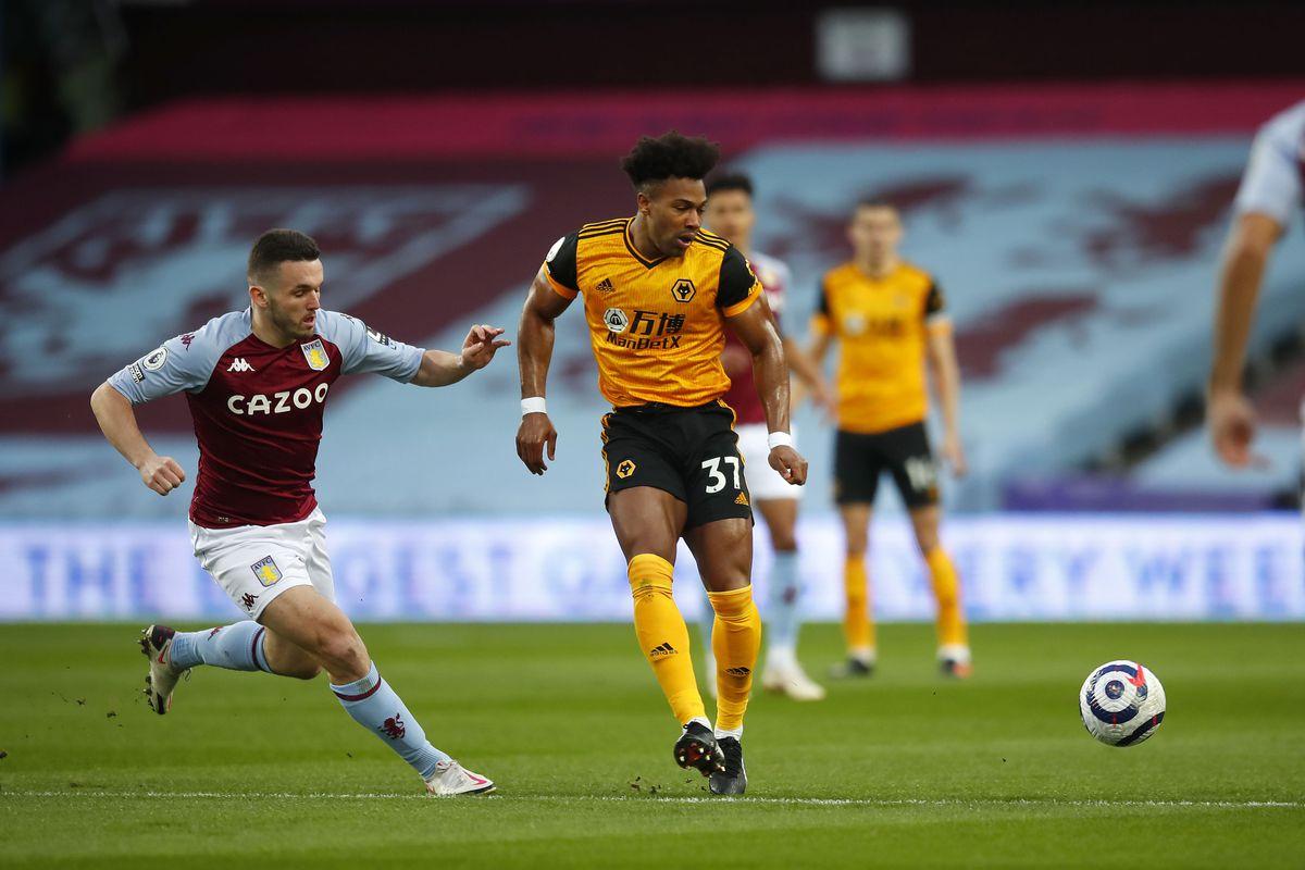 John McGinn of Aston Villa challenges Adama Traore of Wolverhampton Wanderers (AMA)