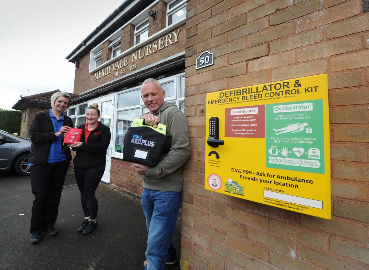 With the new defibrillator and bleed kit, from left manager Michelle Colwell, supervisor Nikola Tonks with Stuart Henley, at Merryvale Nursery, Halesowen