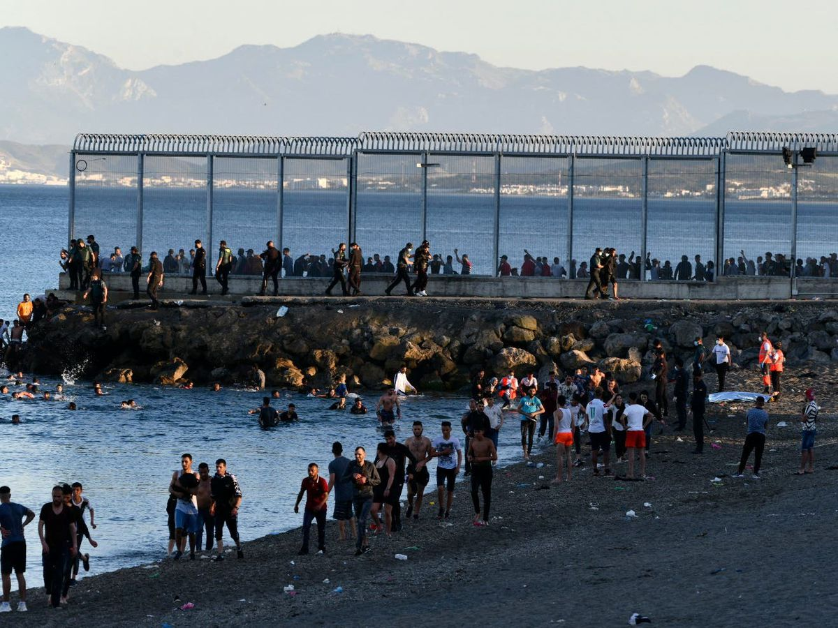 People from Morocco enter the Spanish territory of Ceuta