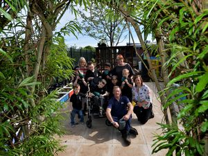 The Orchard school in Oldbury with the help of local business and volunteers  have created a new garden for the students. Pictured is the school gardener Steve Hall with staff and students.