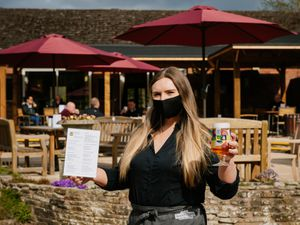 Staff member Ruth Sheldon at Bridgnorth Golf Club's outside bar area funded with a grant from England Golf and the R&A