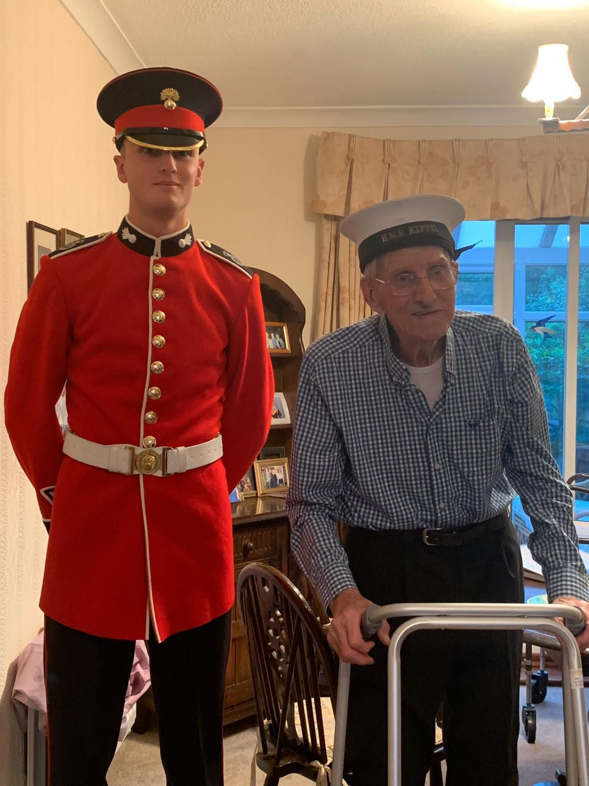 Harry, right, and his great nephew, left, Luke McGann, 19, who has joined the Grenadier Guards