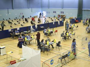 Members of the public at a vaccination centre at Cwmbran Stadium in South Wales