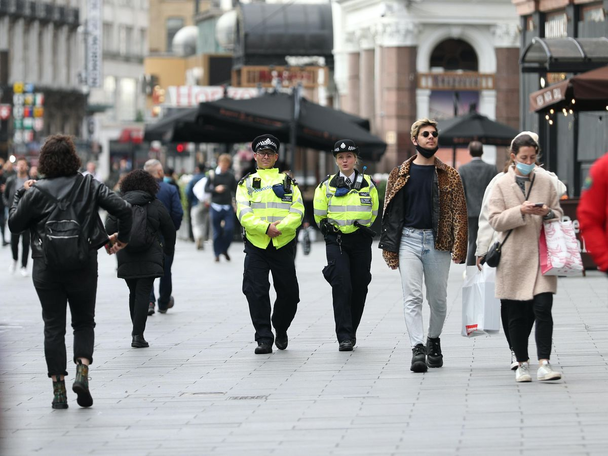 Police officers on patrol in Leicester Square, London