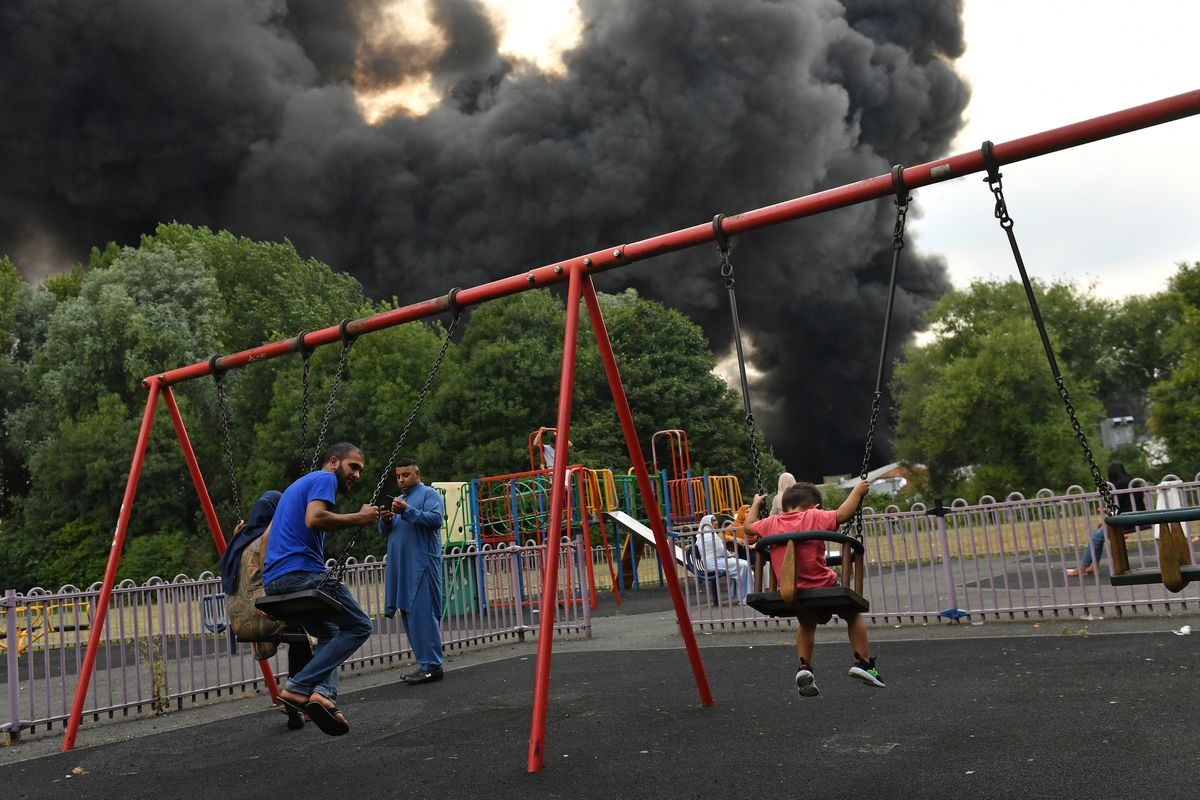 Smoke can be seen behind a park in Birmingham