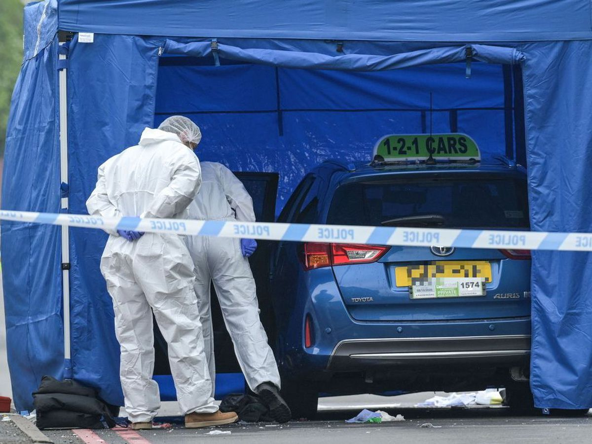 A forensics tent was put up over a taxi from 121 Cars, based in Tipton. Photo: SnapperSK
