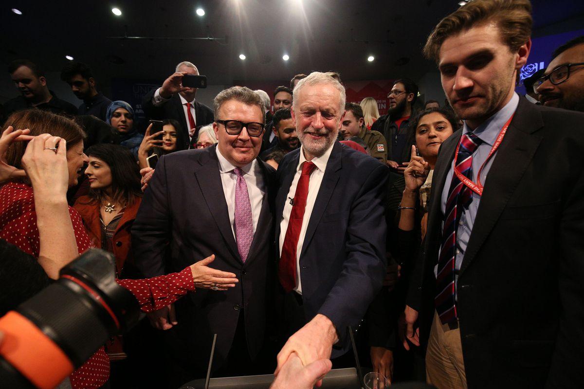 Labour party leader Jeremy Corbyn is congratulated by deputy leader Tom Watson