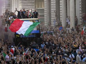 Italy's players celebrate in Rome, Monday, July 12, 2021, their victory of the Euro 2020 soccer championships in a final played at Wembley stadium in London on Sunday. Italy beat England 3-2 in a penalty shootout after a 1-1 draw. (AP Photo/Gregorio Borgia).