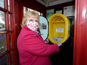 For the second time in six months, the public access defibrillator located in the red telephone box in Shatterford near Upper Arley has been stolen. Pictured with the remaining empty case is councillor Susan Rickhuss